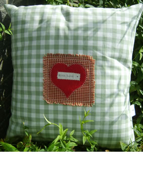 Green gingham heart cushion