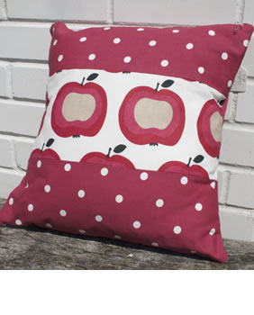 Red spotty apple cushion