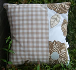Flower print and gingham cushion