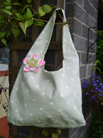 Pale green dotty bag